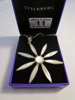 Lot 11 - Silver mother-of-pearl star shaped pendant on chain