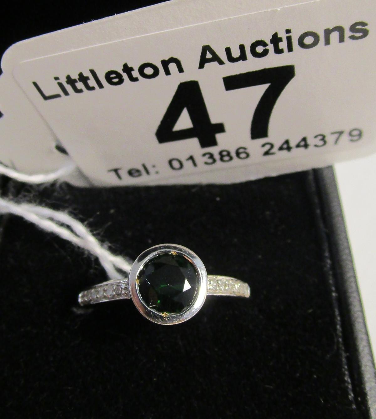 Lot 47 - White gold green garnet & diamond set designer ring