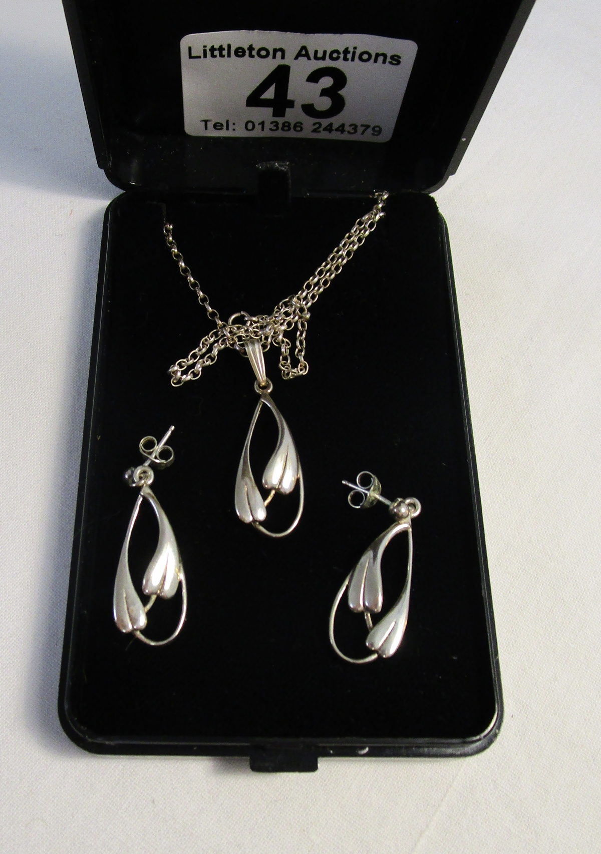 Lot 43 - Silver set of Nouveau style earrings and pendant