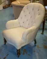 Lot 590 - NURSERY CHAIR, Victorian walnut and white cotton button upholstered with turned supports.