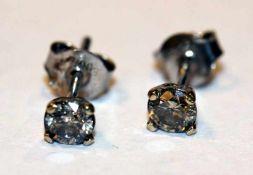 Paar 14 k Weißgold Ohrstecker mit je einem Diamant