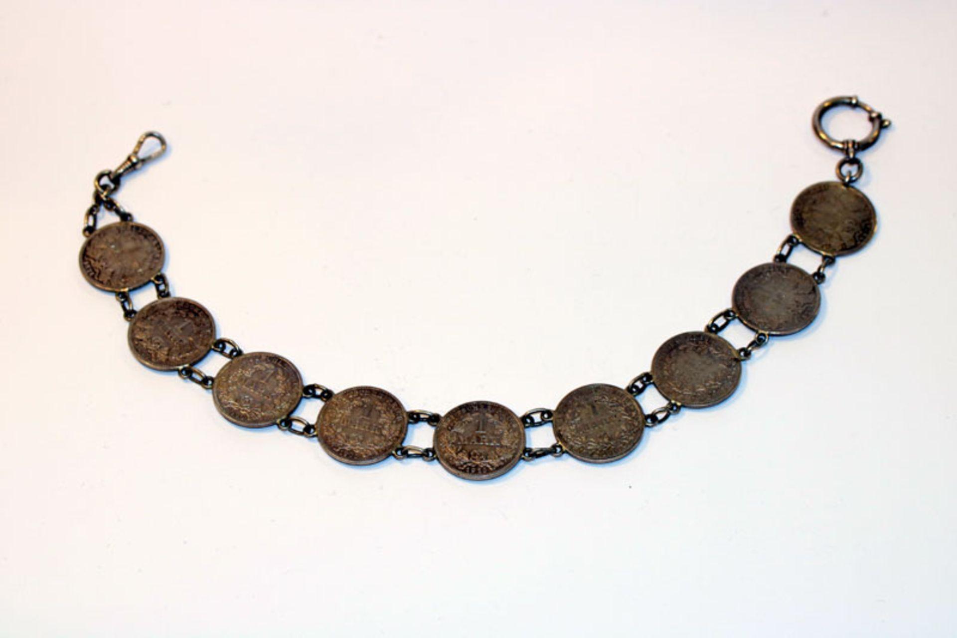 Uhrenkette, 835 Silber mit 9 Reichsmarkmünren, 900 Silber, 60 gr., L 32 cm