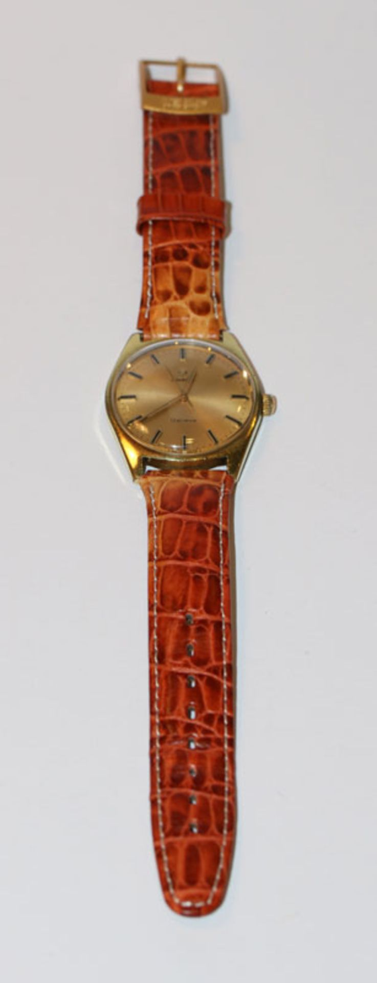 Omega Armbanduhr, vergoldet, mechanisches Werk, intakt, an braunem Lederarband, Tragespuren