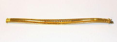 18 k Gelbgold Armband, teils mattiert mit 14 Diamanten, 42,3 gr., L 18 cm, klassische Handarbeit