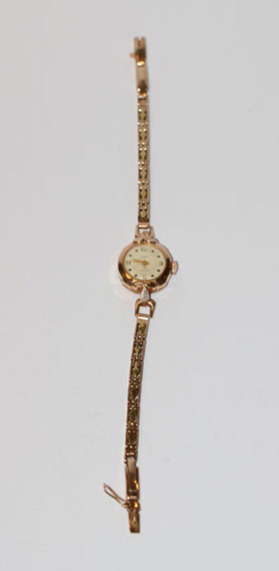 Los 26 - Russische Damen Armbanduhr, 583 Gelb- und Rosegold, 19,4 gr. mit Werk, intakt, L 18 cm, Tragespuren