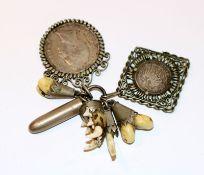 Konvolut von 7 Charivari-Anhänger, Münzen, Grandeln u. a., meist Silber, Altersspuren