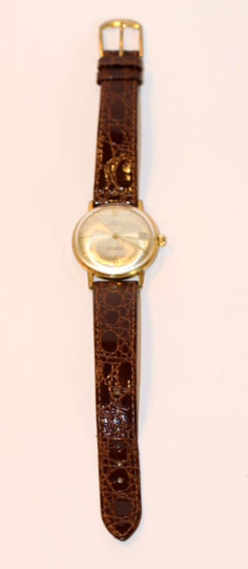 Los 16 - Osco Automatic Armbanduhr um 1960/65, Datumsanzeige, intakt, an braunem Armband, Tragespuren