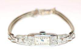 Platin Damen Armbanduhr mit 24 Diamanten besetzt. L ca. 16 cm, klassische Handarbeit