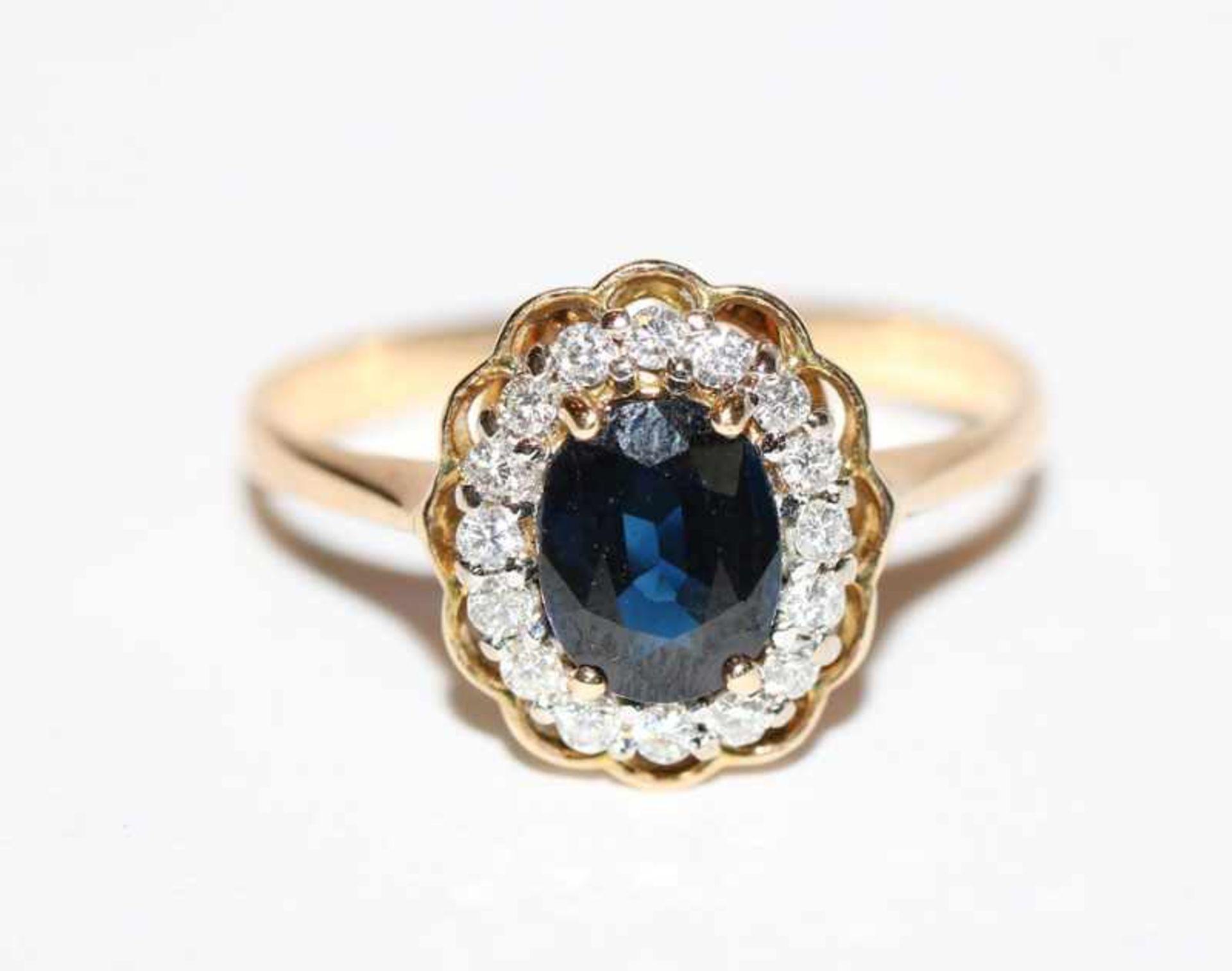 Los 18 - 14 k Gelbgold Ring mit blauem Farbstein und Brillantkranz, Gr. 60, klassische Handarbeit