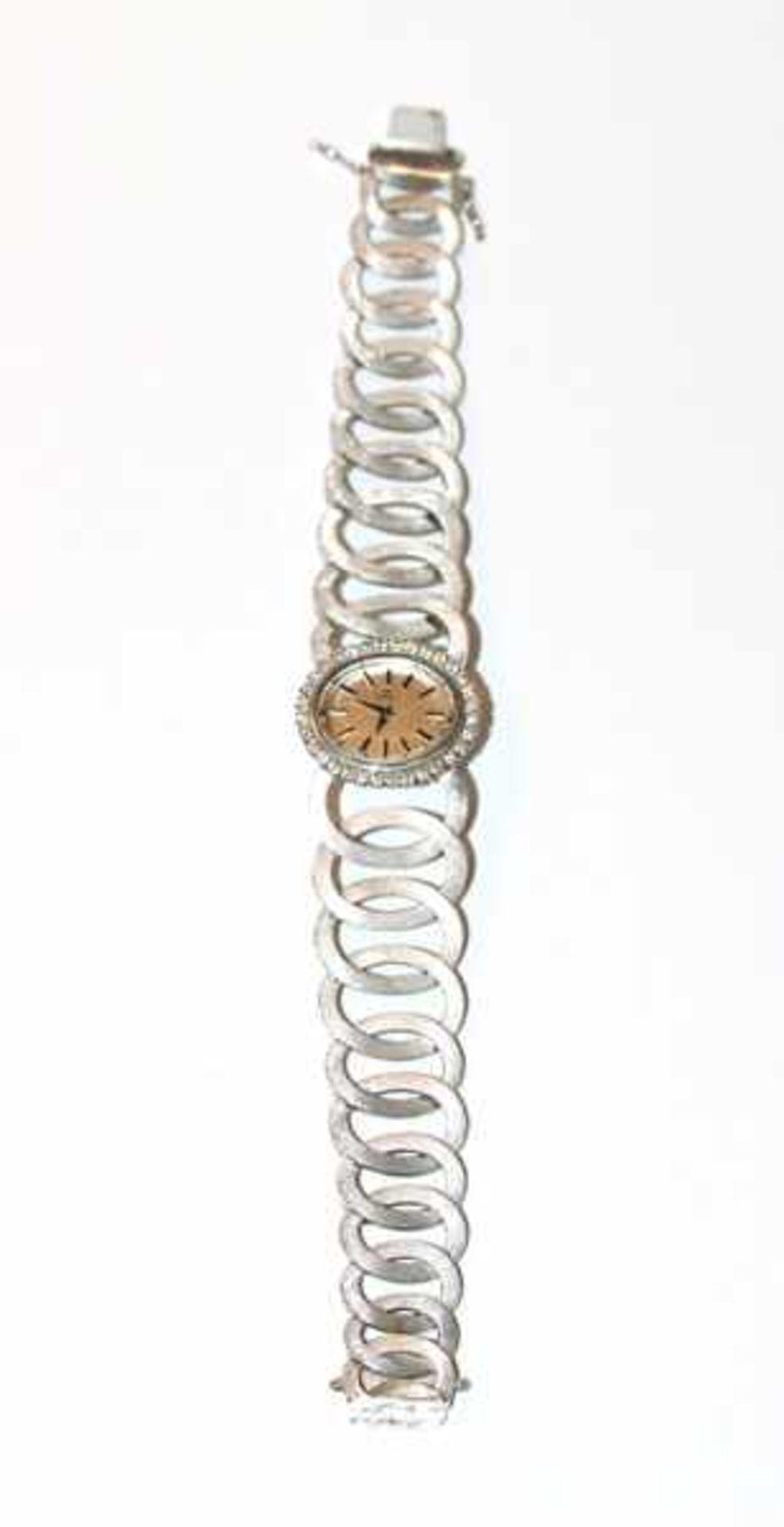 Los 19 - Ebel Damen-Armbanduhr, 18 k Weißgold , Zifferblatt mit 32 Brillanten, zus. 0,68 ct., Armband