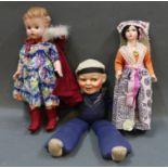 A 1920's musical sailor doll,