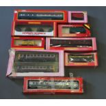 A collection of boxed Hornby coaches,