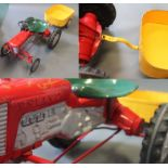 A metal Tri-ang child's pedal tractor with trailer & connecting pin