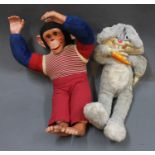 A chimpanzee soft toy & a talking Bugs Bunny soft toy