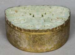 A Chinese jade mounted bronze box The hinged shaped lid inset with a pierced carved jade panel