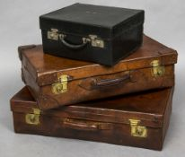 An early 20th century tan leather suitcase, stamped Asprey, London Mounted with brass lock plates,