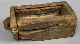 An early dug out wooden chest Of simple form, with losses and alterations. 92 cm long.