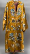 A 19th century Chinse embroidered silk jacket Worked with floral sprays and precious objects on an