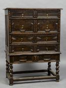 An 18th century oak geometric moulded chest on stand The moulded rectangular top above an
