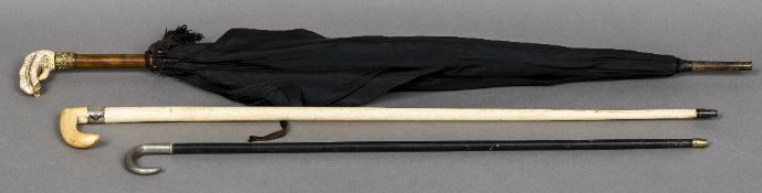 A 19th century white metal mounted whale bone and ivory walking stick The collar inscribed