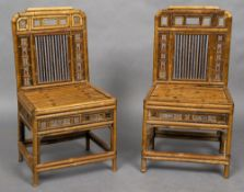 A pair of 19th century bamboo chairs Each back with pierced panels and flanking a central upright