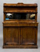 A 19th century rosewood chiffonier With shaped twin tiered mirror backed above two frieze drawers