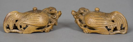 A pair of Chinese carved soapstone wine ewers Each formed as a bird, the spout formed as a branch.