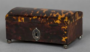 A George III unmarked silver mounted tortoiseshell casket Of hinged domed form,