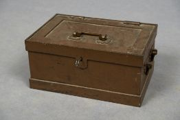 A strong box Of typical form, with side and top handles. 45 cm wide.