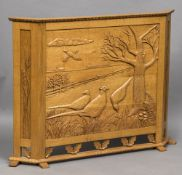 A quarter sawn light oak fire screen Carved with pheasants in a field,