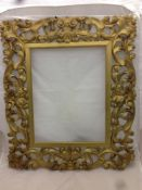 A 19th century carved giltwood framed wall glass The framed probably Venetian,
