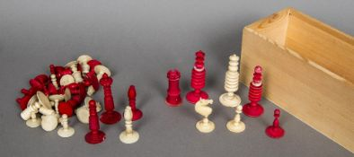 A mid 19th century ivory and stained ivory chess set Together with another ivory chess set.
