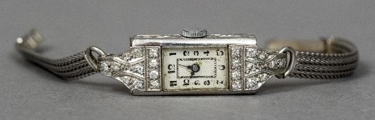 An Art Deco platinum lady's cocktail watch The sixteen jewel movement by Junel, Switzerland,