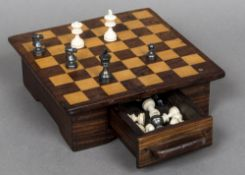 An ivory and stained ivory Staunton pattern chess set, circa 1900 One side natural in colour,