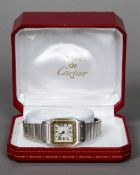 A boxed Must de Cartier lady's wristwatch Of riveted square section form,