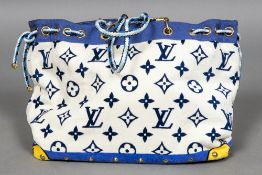 A large Louis Vuitton monogrammed towelling beach bag With plaited rope handles. 54 cm wide.