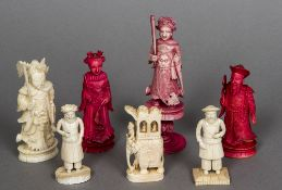 Seven various 19th century ivory and stained ivory chess pieces The largest 11.5 cm high.