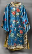 A 19th century Chinese embroidered silk jacket Worked with floral sprays and insects on a sky blue