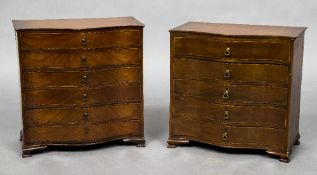 A near pair of Edwardian mahogany miniature serpentine chests of drawers Each shaped top above