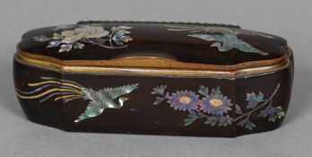 A 19th century mother-of-pearl inlaid lacquered box Of shaped hinged form,