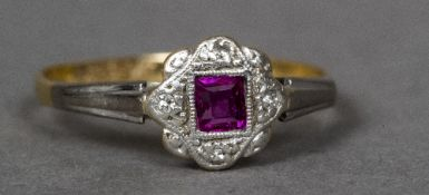 An 18 ct gold and platinum square cut ruby and diamond ring Of flowerhead form.