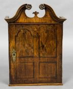 An 18th century walnut and oak spice cupboard The moulded broken swan neck pediment above the