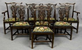 A set of eight Hepplewhite style dining chairs,