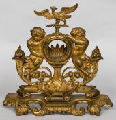 A 19th century gilt bronze watch stand The vacant aperture surmounted with a ho-ho bird flanked by