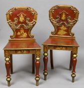 A pair of 19th century hall chairs With red and gold chinoiserie lacquered decoration. 42 cm wide.