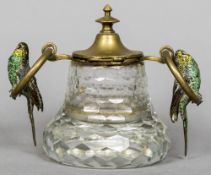 A facet cut glass inkwell Mounted with a hinged lid and two loop handles,