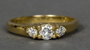 An 18 ct gold three stone diamond ring CONDITION REPORTS: Generally in good