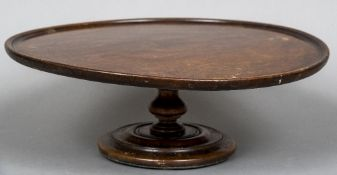 A Victorian mahogany Lazy Susan The revolving dished circular top above the turned column and a