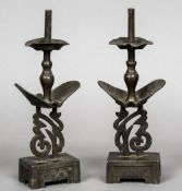 A pair of 19th century Oriental patinated white metal candlesticks The central column with two