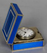 A French silver gilt and enamelled travelling timepiece,